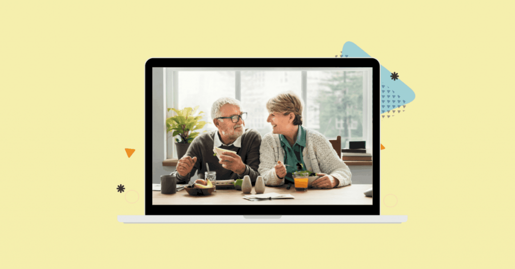 image of a senior couple eating a meal together and smiling inside a computer screen